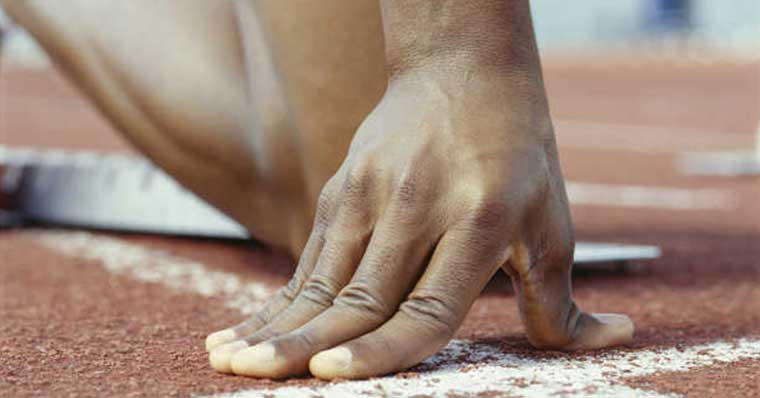 Athletes hand on the track