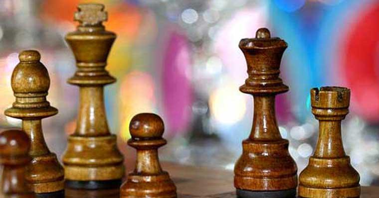 Chess pieces against a colour background