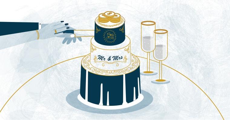 A couple cuts their destination wedding cake