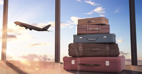 suitcase stacked as airplane departs