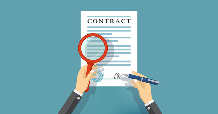 A magnifying glass over a contract