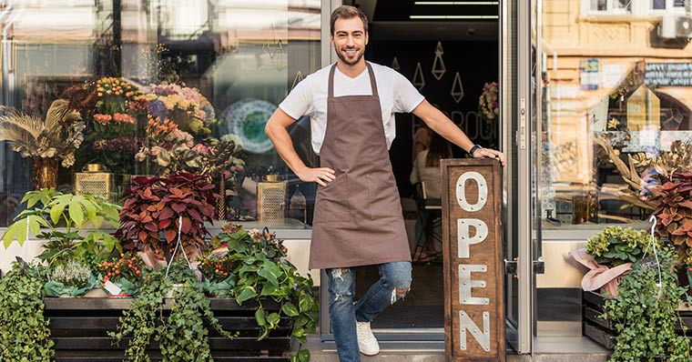 man in front of shop