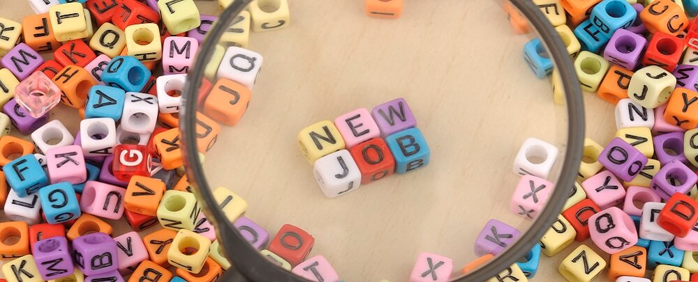 New job spelled out on beads