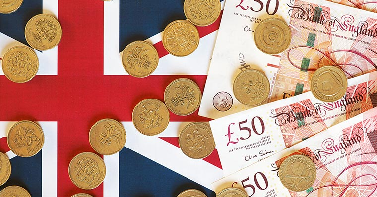 Pounds and coins lying on flag