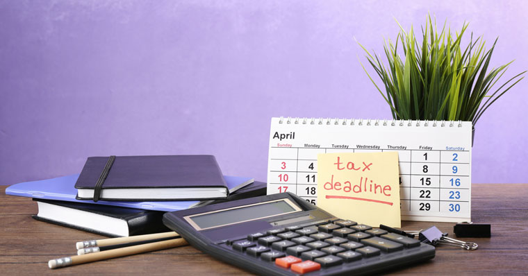 Tax deadline on desk with stationery