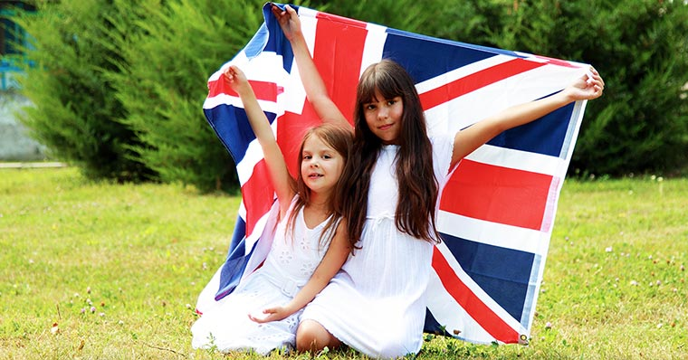 Two children holding UK flag